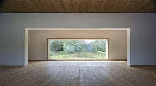 A whte wall with a huge picture window
