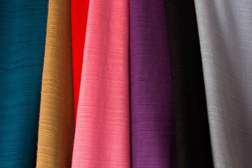 An assortment of different colored fabrics