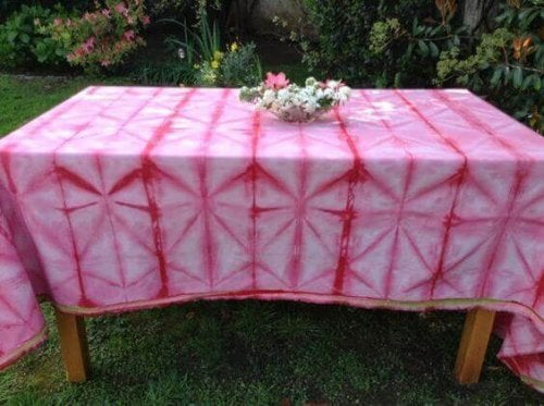 Pink and red tie-dyed table cloth