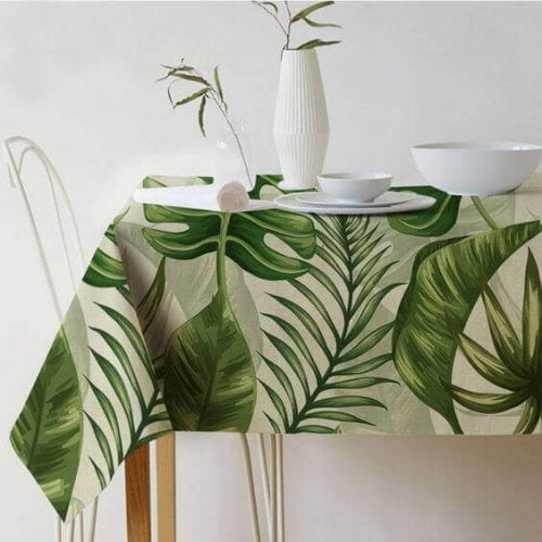 A festive tablecloth with larage green ferns