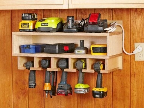 Tools organized in a wooden shelf.