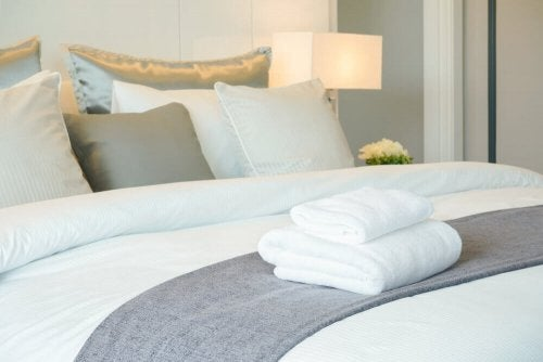 White towels on a bed.