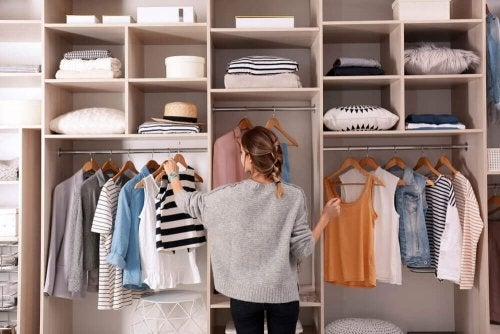 A woman organizing her clothes to get more closet space.