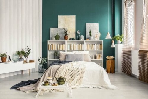 A bedroom with a bookcase.