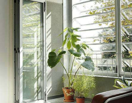 A bright room with one of the various type of windows.