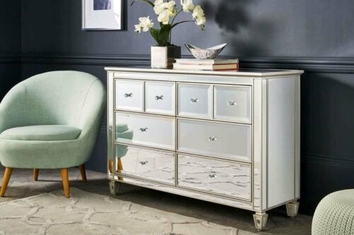 A commode with shinny drawers.
