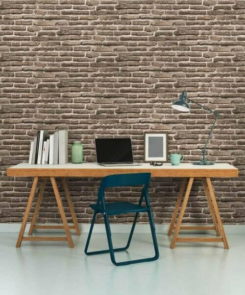 A desk in front a brick wall.