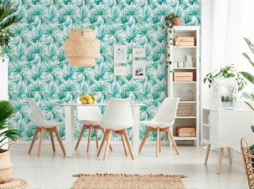 A dining room with painted wallpaper.