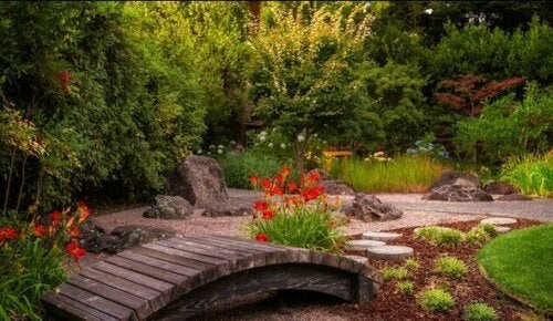 A lovely wooden garden bridge.