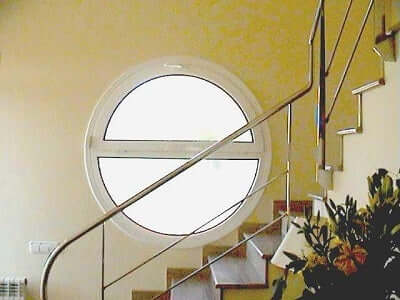 A staircase with a metallic rail.