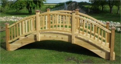 A wooden garden bridge before installation.