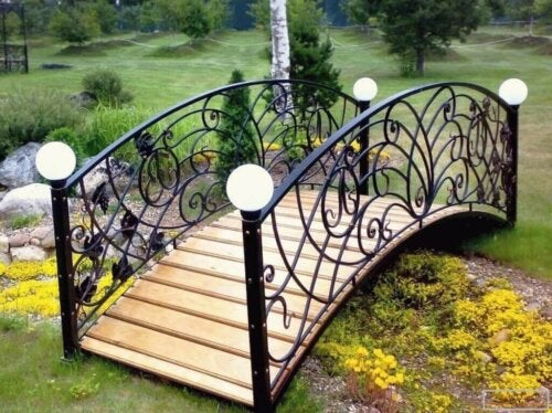 An iron and wood garden bridge.