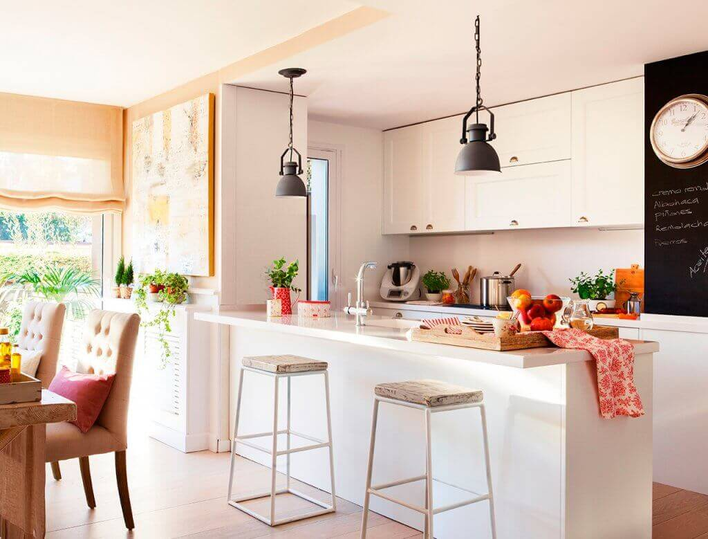 A bright kitchen with stool seating.