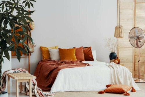 A bedroom with orange hues.