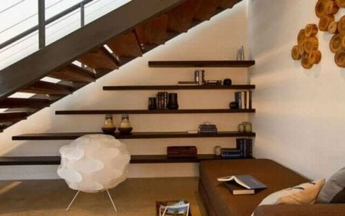 A shelving unit underneath a staircase.