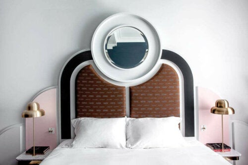 Art deco style bed with a mirror on the headboard