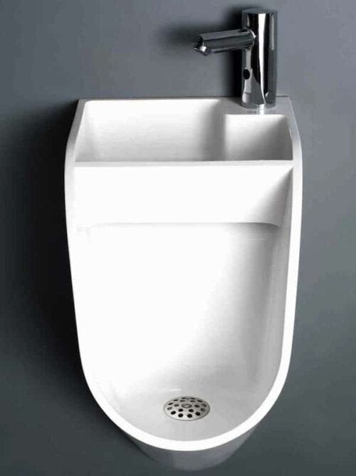 A urinal with a sink included.
