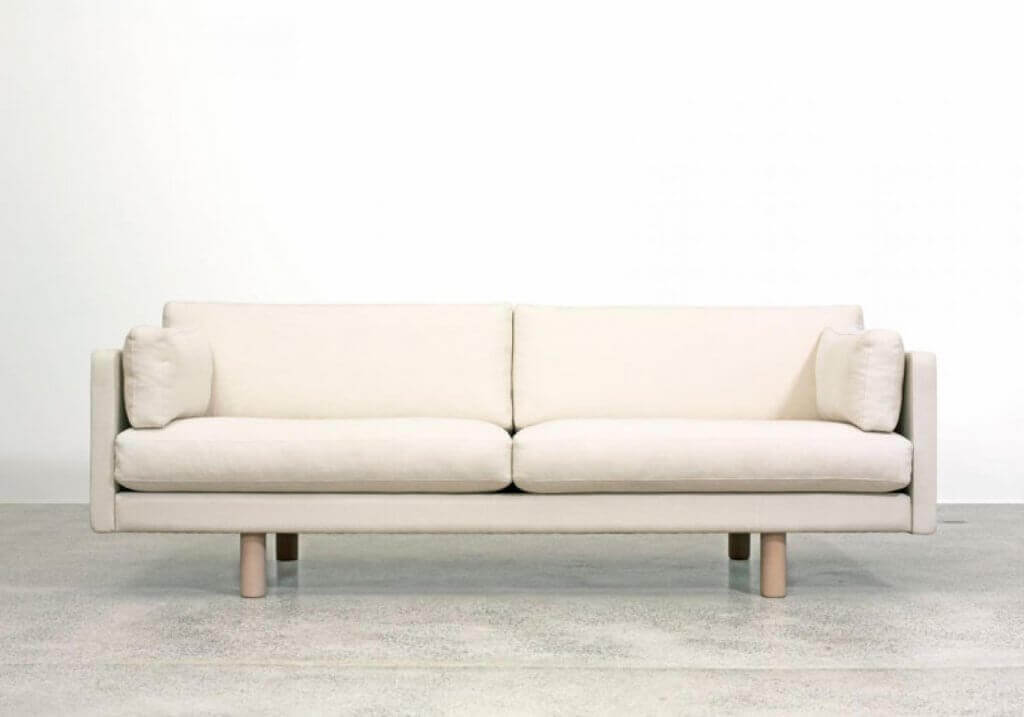 A white couch in a room.