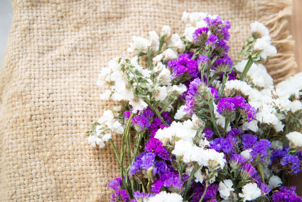 Flowers on a natural, fiber fabric.