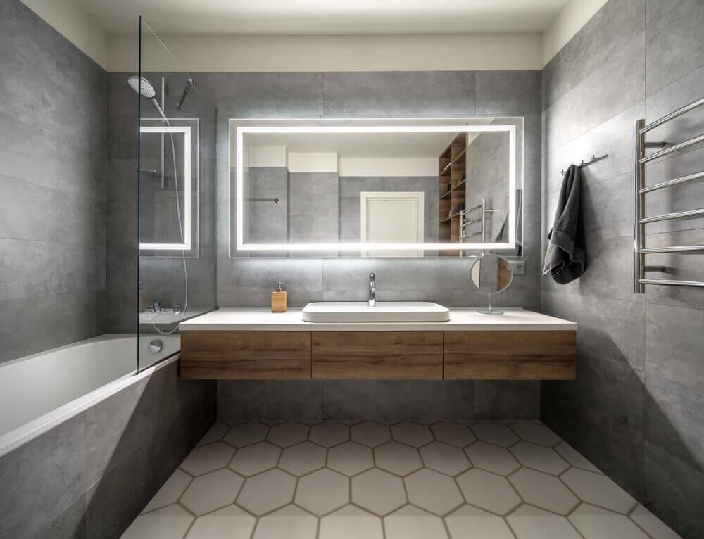An illumniated mirror in a bathroom.