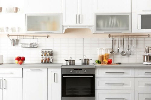 A white kitchen with handles on the cabinets.