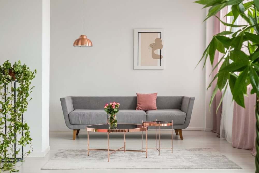 A living room with pink metallic accents.