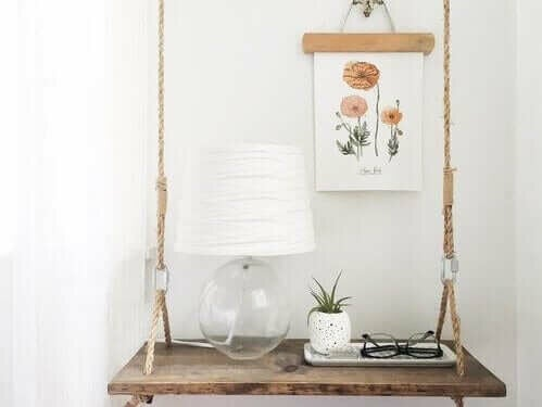 A hanging nightstand with small decorations.