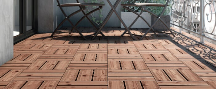 An outdoor patio made with pallet floors.