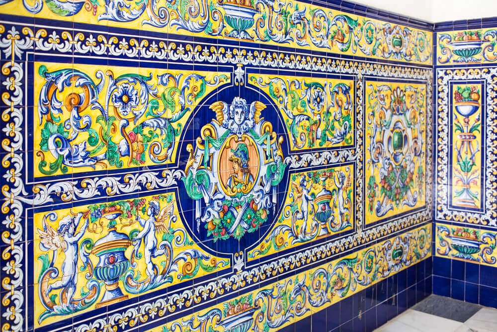 An intricate tiled design in the style of an Andalusian patio.
