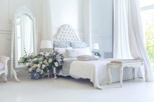 A bedroom decorated with pastel, light colors.