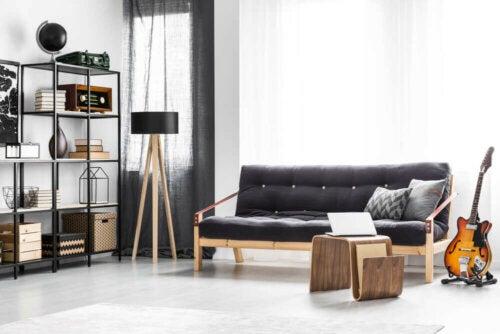 Black sofa in a white living room