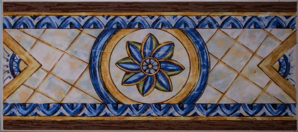 A tile strip featuring a blue flower.