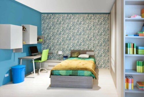 A youth bedroom in blue and green.