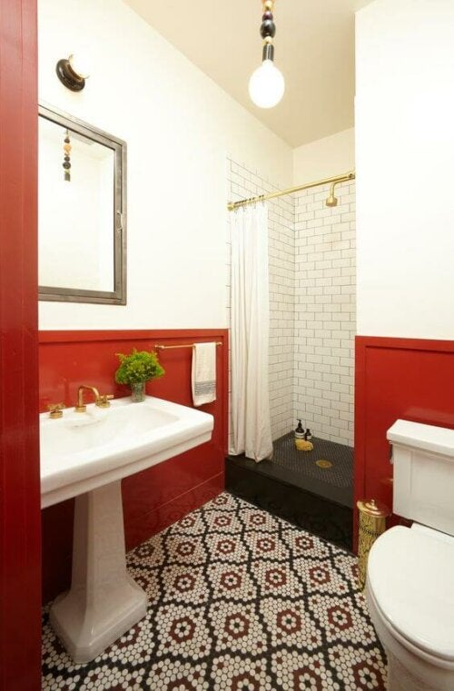 A bathroom with red, black and white.