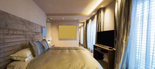 A bedroom with recessed light bulbs.