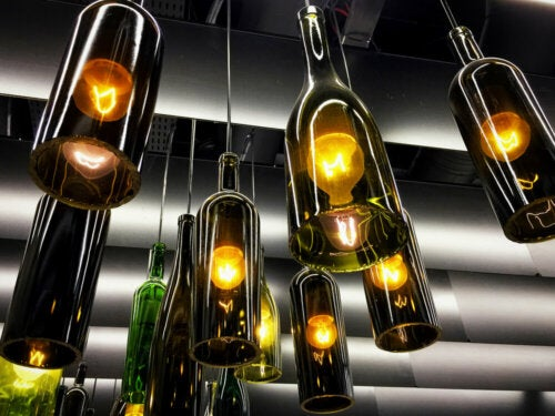 A lamp fixture made by reusing wine bottles.