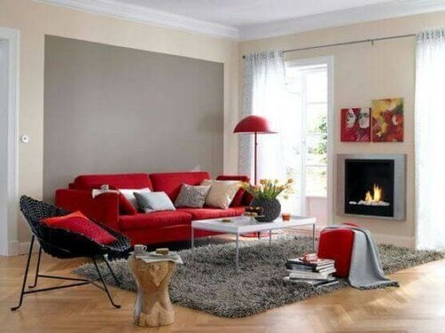 A room with a red color sofa.