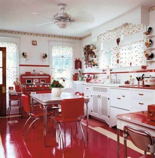 The application of the red color in a kitchen.