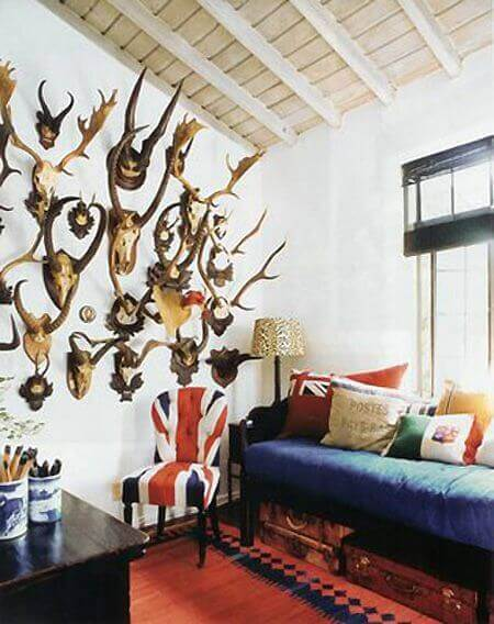A wall filled with animal heads and skulls