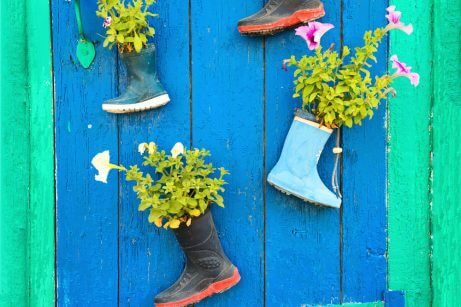 Recycled boots used as flower pots for outdoor decoration