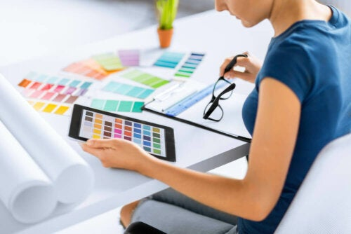 A woman checking out different color palettes.