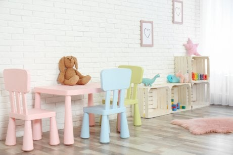 Using wooden fruit crates as short shelves for a pastel themed childrens library