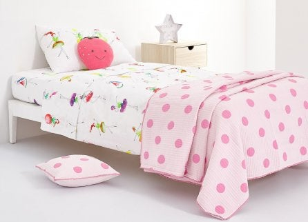 A pink polka dot duvet with fruit themed bedsheets is an original idea for the bedding in a child's room