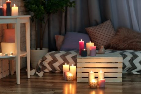 Using scented candles to create a cozy illumination in the bedroom