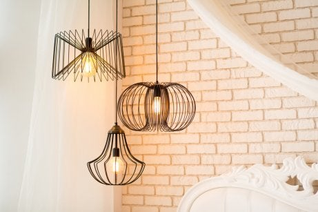Low hanging decorative lights to illuminate dark areas with high ceilings