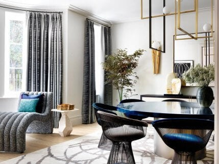 A blue and gray dining room designed by Natalia Miyar