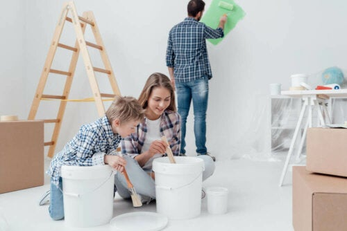 A family painting a room.