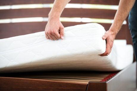A man installing a foam mattress