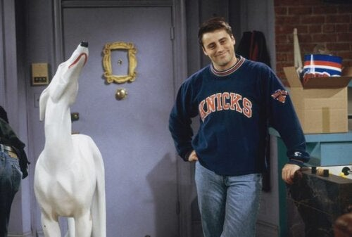 Joey and a ceramic, white dog