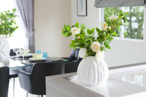 A white vase with a plant in the living room.